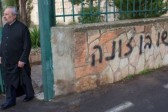Vandals spray-paint hate graffiti on wall of Greek Orthodox church in Jerusalem
