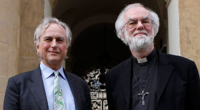 Former Archbishop of Cantebury Rowan Williams (right) and atheist scholar Richard Dawkins pose for a photograph outside Clarendon House at Oxford University, before their debate in the Sheldonian theatre in Oxford, central England, Feb 23 (Reuters/Andrew Winning