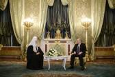 Putin praises Russian Patriarch's care for citizens' concerns