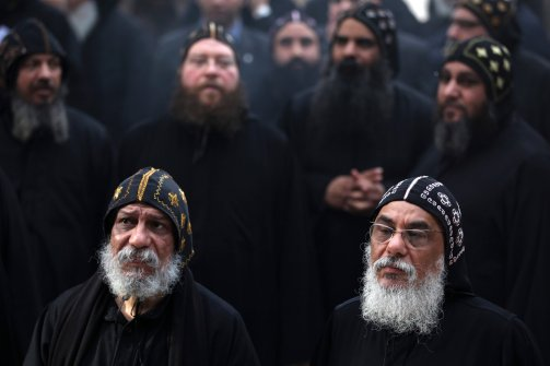 Clergymen gather to wait for the arrival of Egypt's Coptic Christian Pope Tawadros II, at the historic al-Muharraq Monastery, a centuries-old site some 180 miles (300 kilometers) south of Cairo in the province of Assiut, Egypt, on Feb. 5, 2013. (Khalil Hamra/AP)