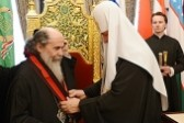 Primate of Russian Orthodox Church presents His Beatitude Patriarch Theophilos with Order of St Vladimir, Equal-to-the-Apostles