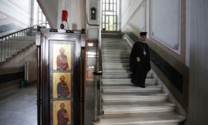 "Metropolitan Apostolos Daniilidis, an Orthodox bishop at the monastery attached to the Halki school, is seen at ""Tracing Istanbul,"" an exhibition of works by Greek artists, at the Greek Orthodox seminary in Heybeliada island near Istanbul, Sept. 4, 2010. (photo by REUTERS/Osman Orsal)"