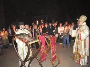 Metropolitan Elpidophoros Lambriniadis (R) leads the night ritual during the Easter celebrations held on the Heybeliada Island, close to Istanbul.