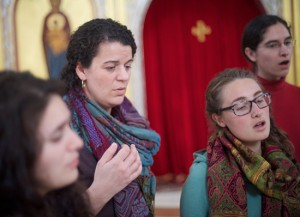 Christina Stavros, who participated in a pilot version of the Byzantine Music program this year at Holy Cross, helps lead the HCHC Women's Byzantine Choir during a recent recording session.