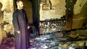Father Ayoub Youssef said Muslim neighbours helped him escape during the attack on his church