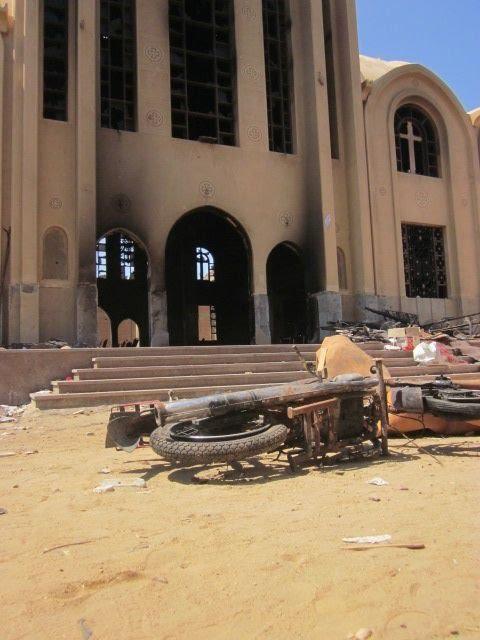كنيسة العذراء بقرية المنزلة بمحافظة الفيوم بعد حرقها