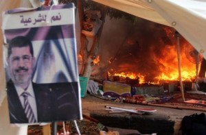 A protest camp is torched in Cairo's al-Nahda Square, on August 14, 2013. Supporters of deposed Islamist president Mohamed Morsi have torched a church in Sohag in a reprisal attack after police dispersed demonstrations in Cairo, according to the MENA state news agency.