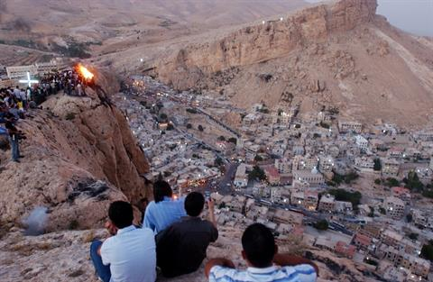 In this Wednesday, Sept. 13, 2006 file photo, thousands of Syrians, most of them Christians, celebrate the Christian Day of the Cross, by setting a fire on top of a mountain in the village of Maaloula, north of Damascus. (AP Photo Bassem Tellawi)