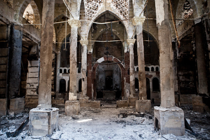 A picture taken on August 18, 2013 shows the Amir Tadros coptic Church in Minya, some 250 kms south of Cairo, which was set ablaze on August 14, 2013. Egypt's Christians are living in fear after a string of attacks against churches, businesses and homes they say were carried out by angry supporters of ousted Islamist president Mohamed Morsi. As police dispersed Morsi supporters from two Cairo squares on August 14, attackers torched churches across the country in an apparent response. AFP PHOTO / VIRGINIE NGUYEN HOANG