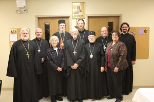 (back row from left) Archpriest Michael Senyo, Archpriest John Jillions, Bishop Melchisedek, Archpriest John Behr, Archpriest Chad Hatfield, Protodeacon Joseph Matusiak; (front row from left) Matushka Anne Hopko, Protopresbyter Thomas Hopko, Metropolitan Theodosius, and Dr. Stefanie Yazge.