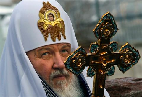 Russian Orthodox Church Patriarch Kirill looks during a service at the construction site of a new St. Spyridon cathedral in Nagatino, Moscow, Russia, Tuesday, March 27, 2012. (AP Photo/Mikhail Metzel)