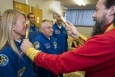 Foreign astronauts take Orthodox priest's blessing and confess before the flight in Baikonur