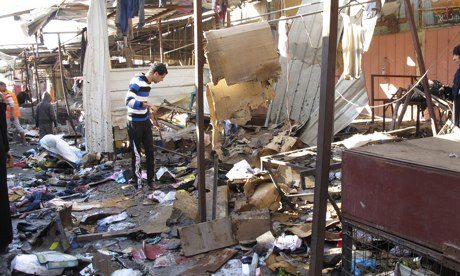 Debris at the site of the attack at the marketplace in Baghdad. Photograph: Reuters