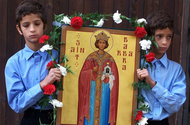Pleased to meet me: With ecumenical fanfare, Saint Barbara's icon makes its debut with the relic in this photo from 1996. (Courtesy of St. Barbara Orthodox Monastery)