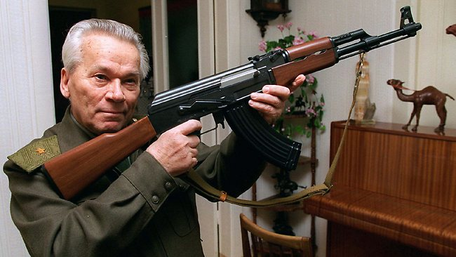 Mikhail Kalashnikov shows a model of his world-famous AK-47 assault rifle at home in the Ural Mountains city of Izhevsk, east of Moscow, in 2007. Source: AP
