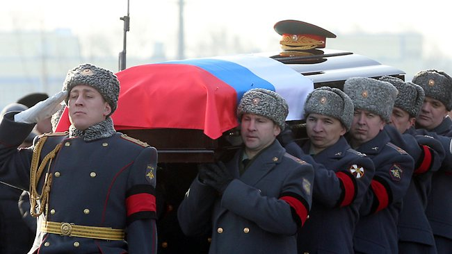 Full state honours... Russian officers carry the coffin of Mikhail Kalashnikov during his funeral ceremony in Mytishchi, outside Moscow.