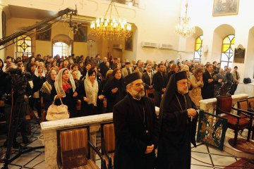 Photo: SANA / Reuters. Armenian Orthodox Christians gather at their church of St Sarkis in Old Damascus for Christmas service, January 6, 2014.