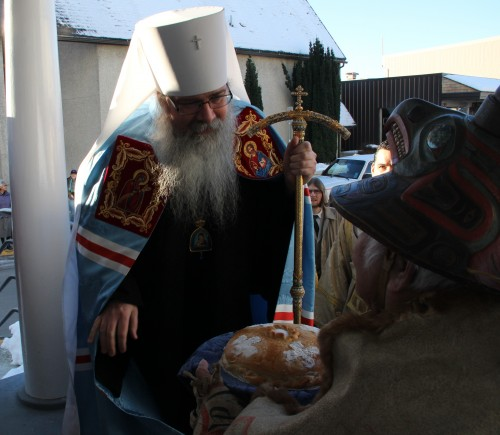 Herman Davis presents Metropolitan Tikhon with bread and salt. (KCAW photo/by Emily Forman)
