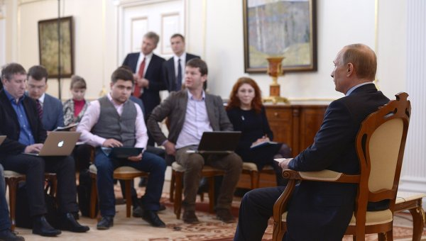 President Vladimir Putin (right) facing journalists at the Novo-Ogaryovo residence to answer questions concerning the situation in Ukraine, March 4, 2014.