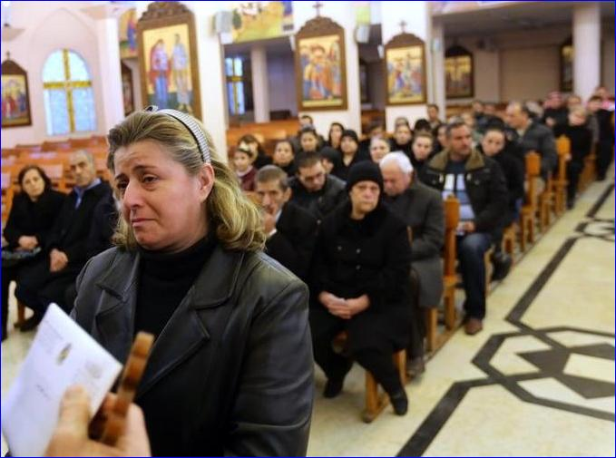 Syrian people from the Christian town of Maalula, a symbol of the ancient Christian presence in Syria which is currently under control of Syrian rebels, including jihadist groups, attend a mass service at the Saint Joseph church on December 18, 2013 in Damascus (Photo: Louai Beshara/AFP/Getty).