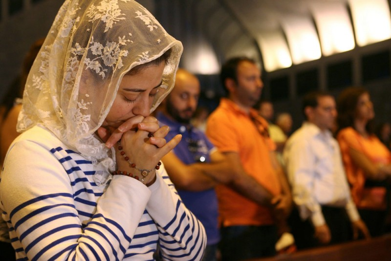 Lebanese and Syrian Christian Maronites pray for peace in Syria, in Harisa, Jounieh September 7, 2013. PHOTO: REUTERS/HASAN SHAABAN