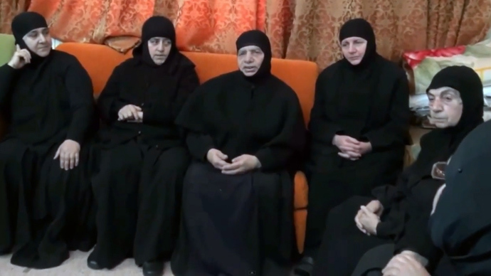 An image grab taken from a video uploaded to YouTube on February 9, 2014, shows a group of nuns from the historic Christian-majority town of Maalula, speaking to the camera from an undisclosed location (AFP Photo)