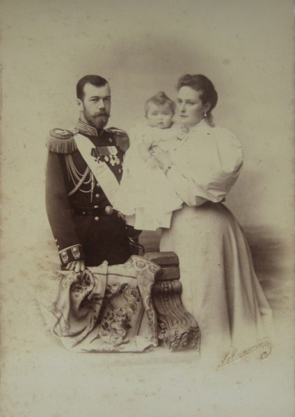 Nicholas II and Alexandra Feodorovna with their daughter Olga