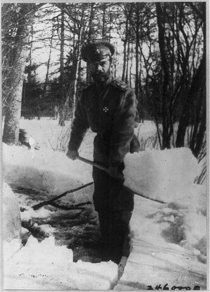 Emperor Nicholas shoveling snow in a park of Tsarskoe Selo, where he was placed after February 1917