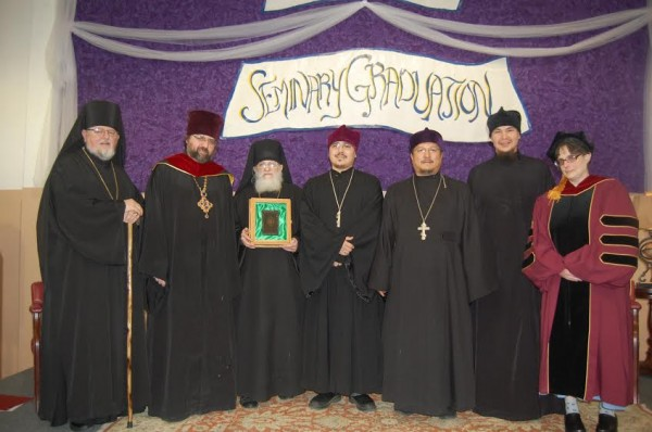 Bishop David with Father John Dunlop, Dean; Father Juvenaly Repass, Chaplain; Fathers Simeon Askoak and Jason Isaac and Deacon Michael Trefon, graduates; and Dr. Beth Dunlop, Professor/ Administrator