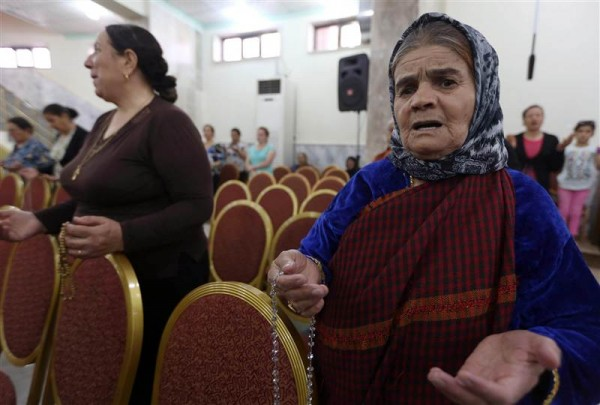 Iraqi Christians who fled the violence in the northern city of Mosul pray at a church in the village of Qaraqosh on July 19. Photo: NBC News