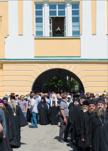 Patriarch Kirill exits through the monastery's main gates.