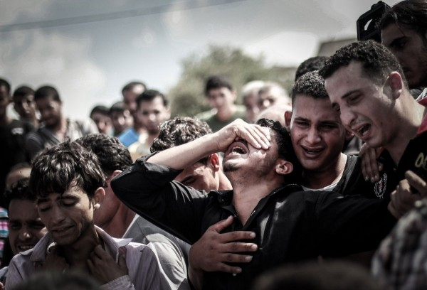 Palestinian relatives mourn during the funeral of eight members of the same family who were killed overnight in an Israeli strike on July 19, 2014 in Beit Lahia, north of the Gaza strip. (Hosam Salem—NurPhoto/Corbis)