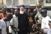 Despite the Danger, Courageous Former Rock Star Turned Missionary, Fr. Themi Adams, Has Decided to Stay Put with His Flock in Sierra Leone