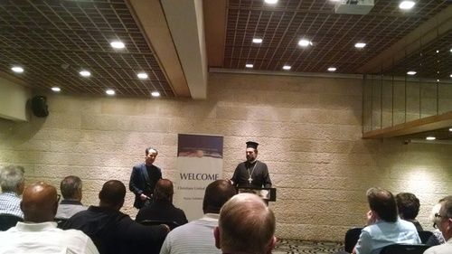 Father Gabriel Nadaf addresses a group of 51 Evangelical pastors from the U.S. on Tuesday. Photo: Sean Savage.