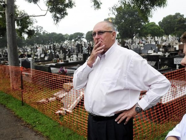 Ian McIntosh, CEO of the Rookwood Necropolis Trust, inspects the damage. Picture: Phillip Rogers