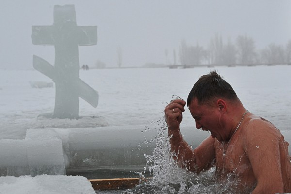 Russian Orthodox Christians plunge into icy rivers and lakes to celebrate the Epiphany