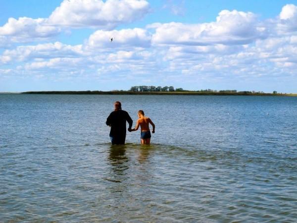 Vladika Philip baptizes children in the lake near the village of Blagodatnoye, August 18, 2012.