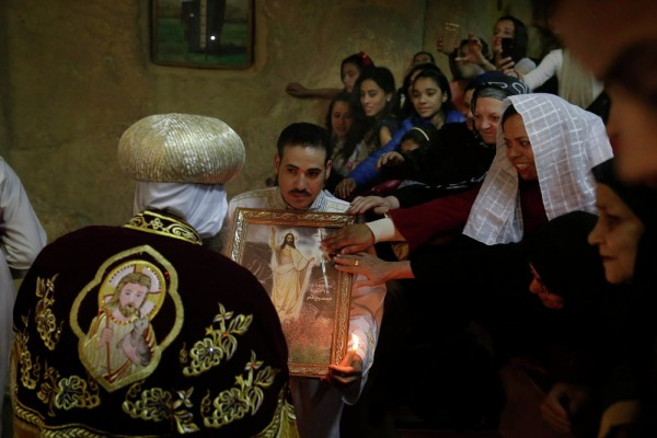 Egyptian Coptic Christian pray during the Easter Eve service at St. Sama'ans Church in the Mokattam district of Cairo, Egypt. April 11, 2015.