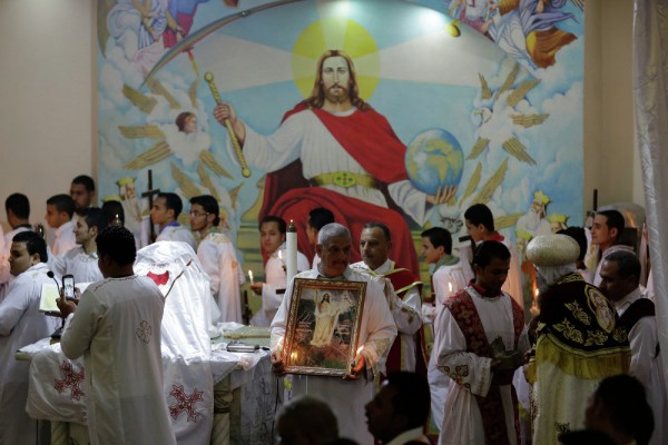 Egyptian Coptic Christians pray during the Easter Eve service at St. Sama'ans Church in the Mokattam district of Cairo, Egypt. April 11, 2015.