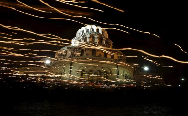 Worshippers walk with candles around the golden-domed Alexander Nevski cathedral during the Orthodox Easter service in Sofia. April 12, 2015.