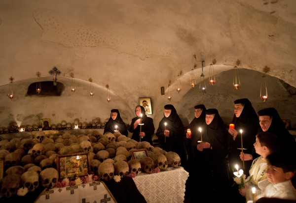 Romanian nuns and believers attend a religious service during Easter celebrations at the Pasarea Monastery in Pasarea. April 11, 2015.