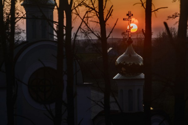 The Sun sets behind the St. Yelisei's Lavrishevo monetary during Orthodox Easter at the village of Gnesichi in the Grodno region, about 150 km from Minsk, Belarus. April 11, 2015.