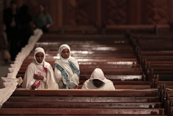 Ethiopian Christian women pray during the Easter Eve service at St. Mark's Cathedral, in Cairo, Egypt. April 11, 2015.