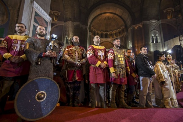 Men dressed as Serbian knights attend an Orthodox Easter service in the St. Sava temple in Belgrade. April 12, 2015.