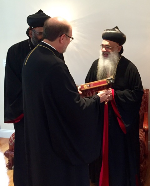 Fr. Chad Hatfield, Chancellor of St. Vladimir's Seminary, presents Bible to the Catholicos.