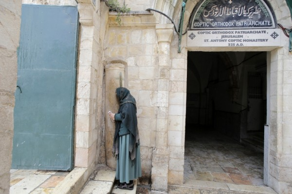 PHOTO: REUTERS/AMMAR AWAD. A worshipper prays outside the Coptic Orthodox Patriarchate during a prayer service in Jerusalem's Old City for 21 Egyptians Christians whom Islamic State militants beheaded, according to a video released earlier this week, February 18, 2015.