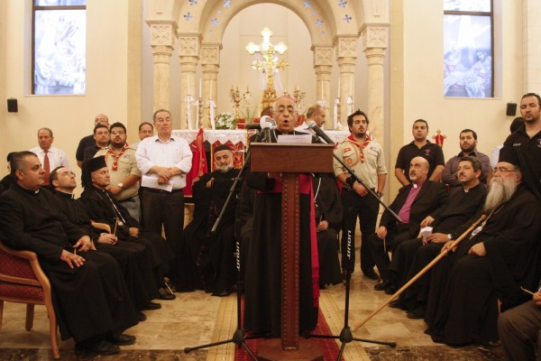 (PHOTO: REUTERS/MAJED JABER. Jordanian Christian clerics hold a mass at the Syriac Orthodox Church in Amman, May 21, 2013.