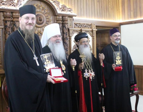 Catholicos Paulose presents commemorative gifts to Fr. Behr, Metropolitan Tikhon, and Fr. Voytovich. Photo: http://oca.org