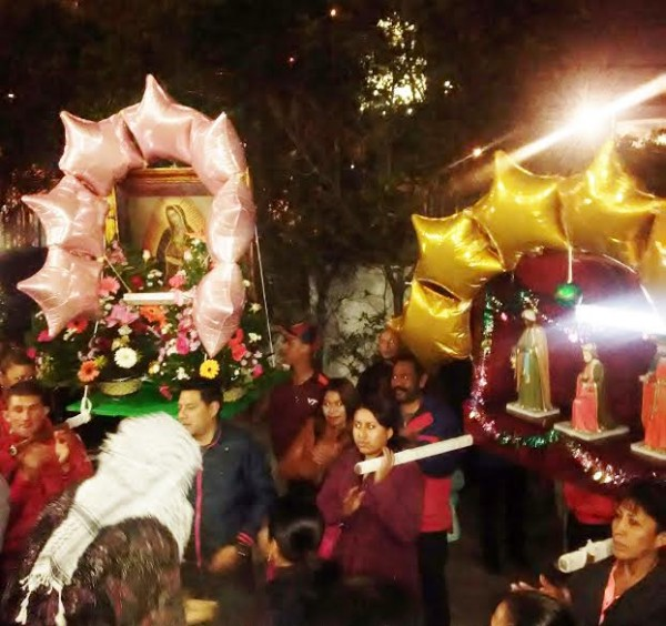 Street procession honoring the Magi pauses in front of the Cathedral of the Ascension.