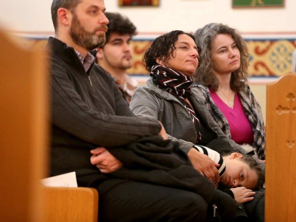 A young boy gets comfy on his mom's lap as the service wears on. JULIE OLIVER / OTTAWA CITIZEN